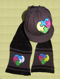 Knit Cotton visor Cap with a Rayon chenille and cotton scarf hand painted with the autism heart puzzle