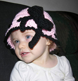 Whimsical crochet hat with a bow in sizes baby thru adult