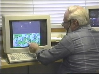 Bob Fratzke showing the Winona Camo Design on the computer at Winona Knitting Mills