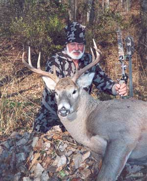 Bob Fratzke with his Whitetail, wearing Winona Camo and Winona Survivor Cap