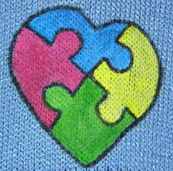 Autism heart puzzle handpainted on a knit scarf