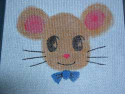 The Painting of Anime Mister Mouse has to dry before assembling the knit baby sweater.