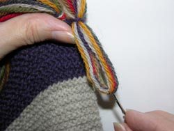 Pull the strand of yarn through the Scarf Edge far enough to create a circular loop.