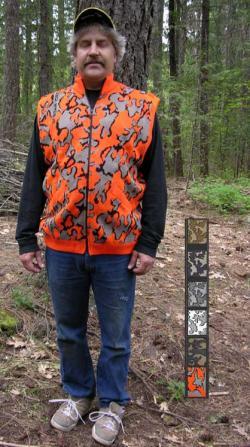 A Knit Winona Camo Classic© Vest shown in color R: Blaze orange / black / grey
