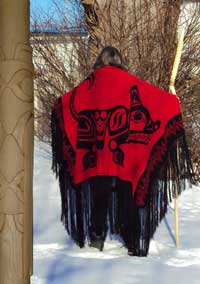 Carver, Peter Paylor wearing a handloomed Wolf dance shawl, back view