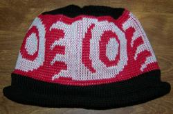 Knit Cap in Pacific Northwest Art Style Featuring Big Bear Paw Design